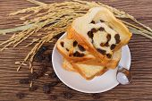 pic of home-made bread  - slice of home made raisin bread with died raisin - JPG