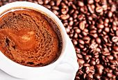 Coffee Cup And Roasted Coffee Beans Background, Close Up