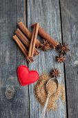 Cinnamon Sticks And Anise Stars On Rustic Wooden Background