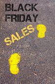 Yellow Footsteps On Sidewalk Towards Black Friday Sales Message