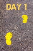 Yellow Footsteps On Sidewalk Towards Day 1 Message