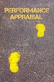 Yellow Footsteps On Sidewalk Towards Performance Appraisal Message