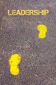Yellow Footsteps On Sidewalk Towards Leadership Message
