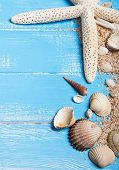 Seashells And Sand On The Blue Wooden Background
