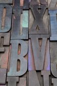 stock photo of letter x  - antique wood letterpress printing blocks with color ink patina - JPG