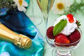 foto of whipping  - Strawberries with whipped cream and champagne on Wimbledon  - JPG