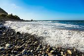picture of atlantic ocean  - Wild stone beach on coast or shore of the Atlantic ocean with waves and foam and blue sky and horizon in Tenerife Canary island Spain - JPG
