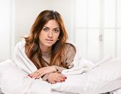 foto of early morning  - young woman laying in bedroom at early morning - JPG