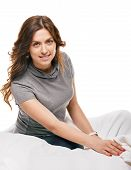 stock photo of early morning  - young woman sitting in bedroom at early morning - JPG