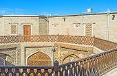 picture of caravan  - The courtyard of the medieval Caravan Saray used as the tourist hotel Bukhara Uzbekistan - JPG