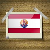 foto of french polynesia  - Flags of french polynesia at frame on a brick background - JPG
