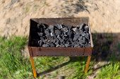 image of brazier  - burning wood in an open charcoal grill - JPG