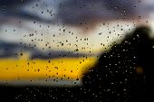 stock photo of rain  - Rain drops on glass panel - JPG
