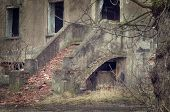 image of homeless  - exterior stairs lead into left collapsing house the object falling into ruin is probably inhabited by homeless people - JPG