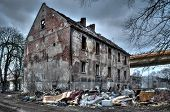 stock photo of homeless  - Left collapsing house the object falling into ruin is probably inhabited by homeless people - JPG