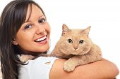 foto of young woman posing the camera  - Young woman posing at camera with redhaired domestic cat - JPG