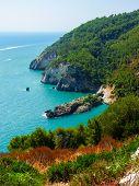foto of promontory  - Rocky cliffs in the coastline of Gargano - JPG