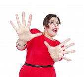 picture of hysterics  - Scared screaming beautiful plus size woman in red dress isolated. Focus on hands
