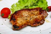 picture of roasted pork  - Roasted pork with pepper and salad leaves - JPG