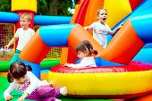 foto of playground  - happy kids having fun on inflatable attraction playground - JPG