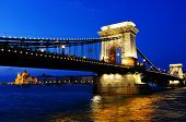 stock photo of hungarian  - Chain Bridge and Hungarian Parliament Building on the bank of the Danube in Budapest by night - JPG