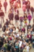 stock photo of population  - General Public Concept with Unrecognizable Crowded Population Out of Focus Blurred Crowd of People On City Street Vintage Toned Image - JPG