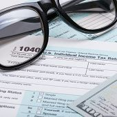foto of cpa  - US 1040 Tax Form glasses and dollars  - JPG