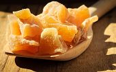 image of candy  - Closeup candied crystallized ginger candy pieces on wooden spoon - JPG