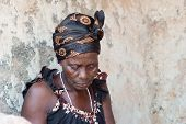 image of loincloth  - This woman is dressed like most african women living in the village - JPG