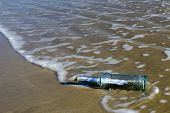 image of lost love  - Message in a bottle washed ashore on a beach - JPG
