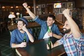 Постер, плакат: people leisure friendship and bachelor party concept happy male friends drinking bottled beer an