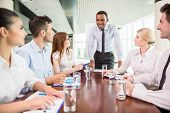 stock photo of leader  - Successful team leader with his team at meeting room - JPG