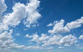 picture of puffy  - white puffy clouds in the blue sky - JPG
