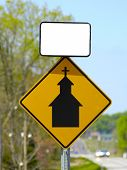 stock photo of deacon  - A sign on the roadside with a church and room for your text - JPG