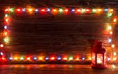 Christmas Lights And Vintage Lantern On Wooden Background. poster