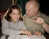Man Showing Woman Computer