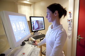 foto of mammography  - Female radiology technician performs mammography test on computer - JPG