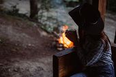 Girl Drinks Coffee At The Background Of The Camp Fire. Romantic Atmosphere. Relaxing Time Camping On poster