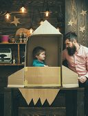 Earth Day Concept. Earth Day Holiday With Father And Small Kid In Paper Rocket. poster