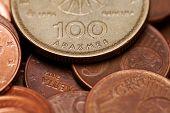 Hundred, Drachmas, Old Greek Coin Among Euro Coins (macro Shot)