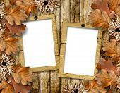 Autumn Frame Of Oak Leaves On A Grange Wooden Background.