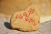 I love you message on a stone