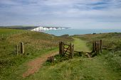 Looking Towards Cuckmere Haven On The Vanguard Way Footpath With Birling Gap And The Seven Sisters I poster