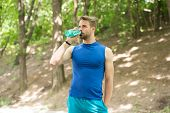 Drinking Water. Man Drinking Water After Training. Man Drinking Healthy Water. Sportsman Has Thirst  poster