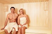 Young couple in sauna