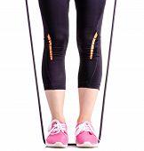Female Legs Sports Leggings Sneakers Sports Exercises Expander For Legs On White Background Isolatio poster