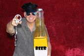PHOTO BOOTH. A man wears a Police Hat, Holds Hand Cuffs, A Giant Beer Bottle and smiles for his pict poster