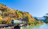 Autumn fall foliage Fukushima Tadami Black Bridge View Point in Fukushima Japan poster