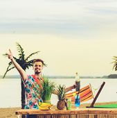 Handsome Caucasian Barman Standing Near The Bar Counter And Having Fun On The Ocean, Photo Toned Sty poster