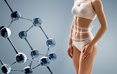 Woman With Perfect Body Near Molecule Chain. Slimming Concept. Improvement Of Metabolism Concept. poster